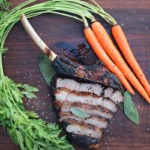caveman veal chop sliced with carrots