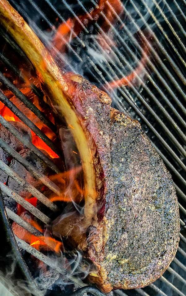 Searing a steak over high heat for Maillard reaction