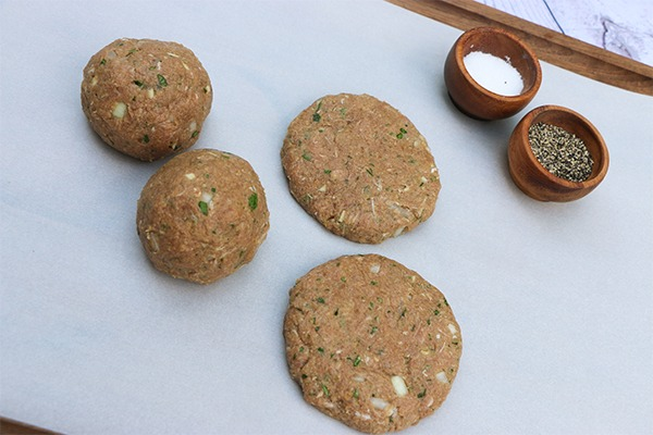 seasoned raw turkey burgers ready to grill