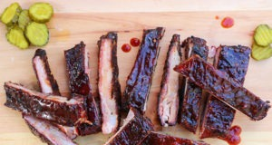 pork spare ribs sliced on cutting board with pickes