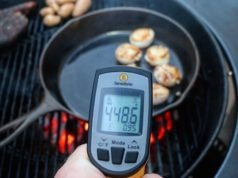 thermoworks infrared thermometer readout of cast iron pan on grill