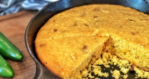 cheddar jalapeño cornbread sliced in cast iron pan