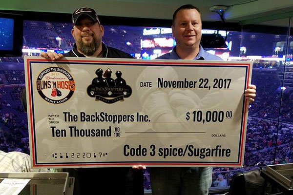 Founders of Code 3 Spices with Check for Backstoppers Charity