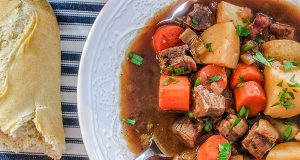 Finished beef stew with roll