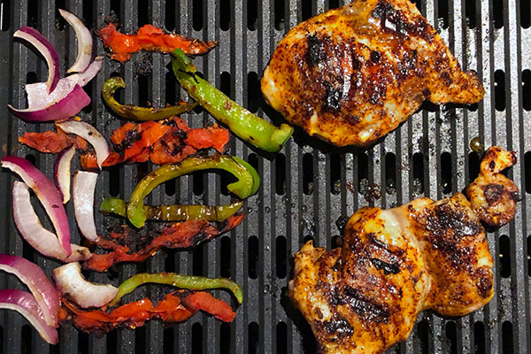 Chicken and vegetables grilled on the Chefman Electric Grill indoors