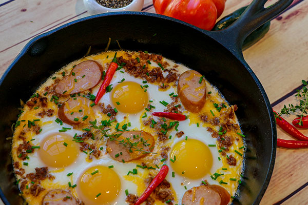 eggs and sausage in a cast iron skillet