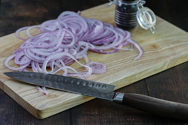 Thinly sliced red onions for the Pickled Red Onion Recipe