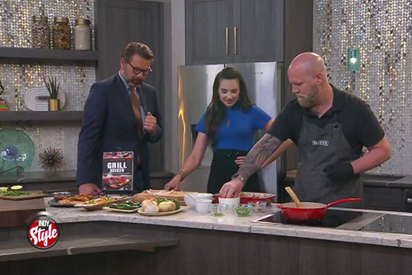 Matt showing Indy Style hosts how to make MOINK Balls