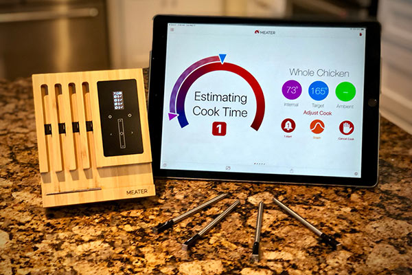 The MEATER Block Thermometer synced to a tablet