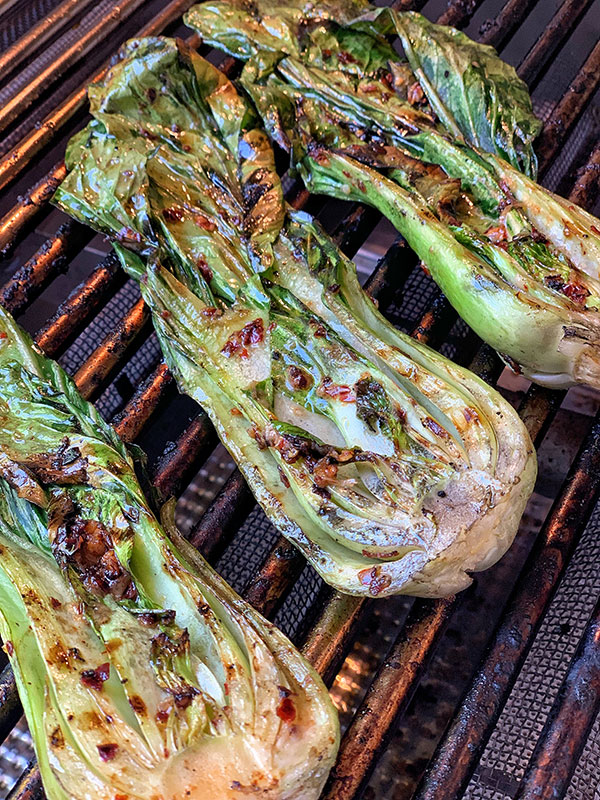Spicy Grilled Baby Bok Choy cooking on high heat