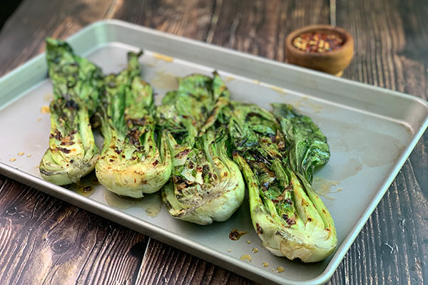 Spicy Grilled Baby Bok Choy with additional red pepper flakes for sprinkling