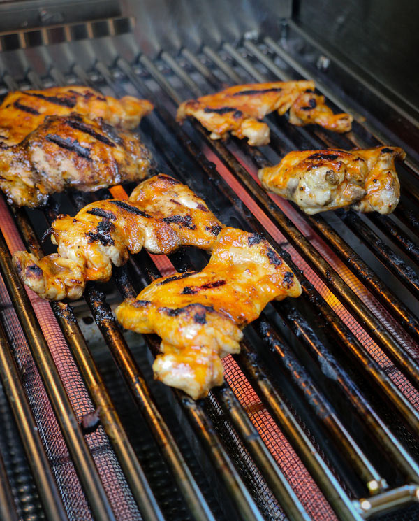 Grilled Honey Sriracha Chicken Thighs Recipe chicken thighs on the grill