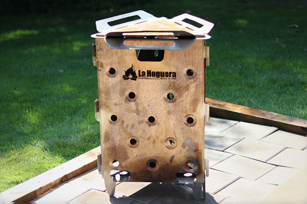 Side view of cooking grate on La Hogurea fire pit