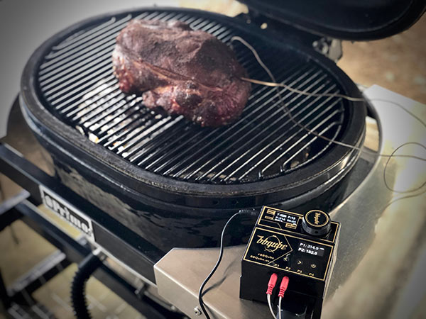 Pork Butt cooking with BBQube temperature control monitoring fan