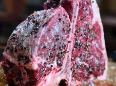 T-bone or porterhouse steak crusted with spices and ready to cook