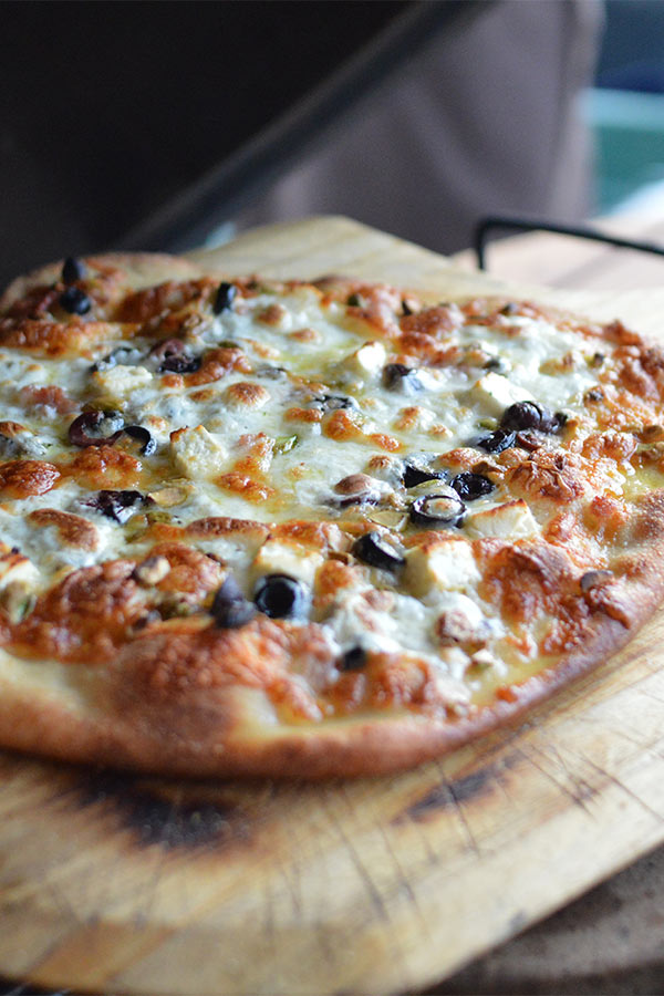 Cheese and Olive pizza grilled on the Kamado Grill