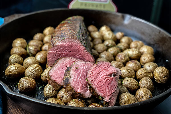 Omaha Steaks chateaubriand sliced over roasted potatoes