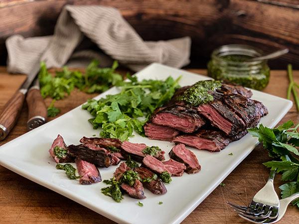 Sliced skirt steak with fresh herbs