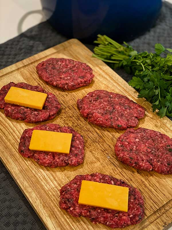 Stuffing cheese into ground beef for Grilled Cheese Stuffed Salisbury Steak