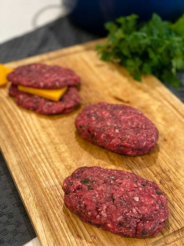 Ground beef patties stuffed with cheese