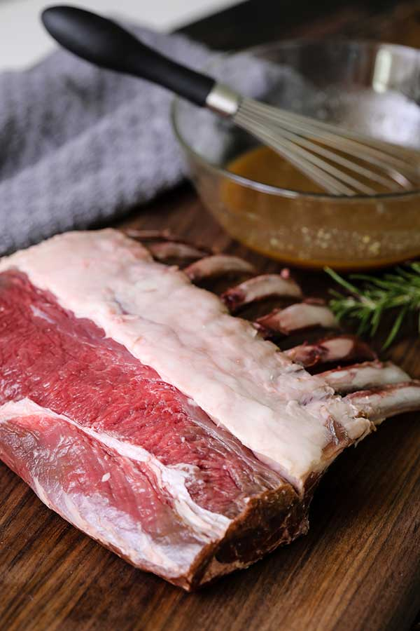Raw lamb with marinade for Maple Dijon Lamb recipe