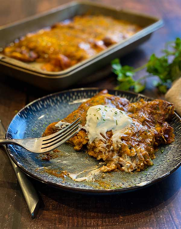 Smoked chicken and cheese enchiladas with sour cream