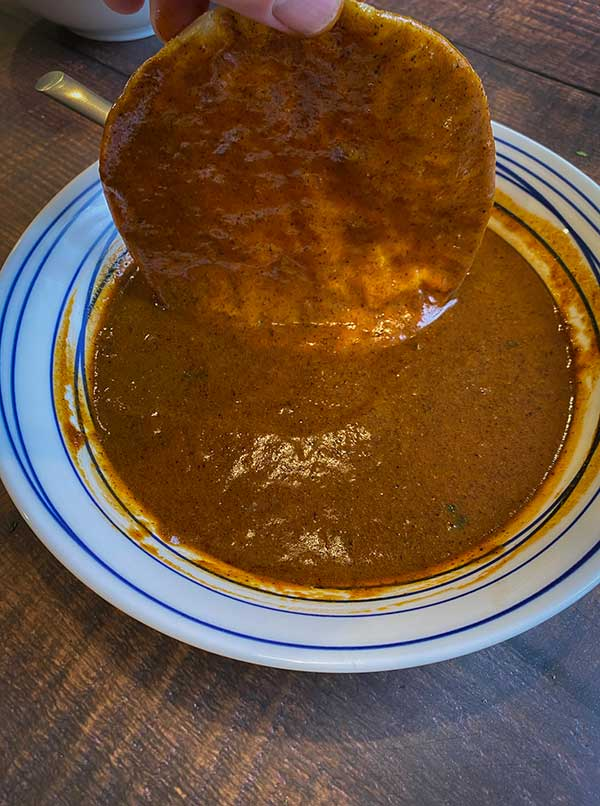 corn tortilla dipped in homemade enchilada sauce