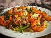 Grilled Argentinian Shrimp with Fettuccine Alfredo plated and ready to serve
