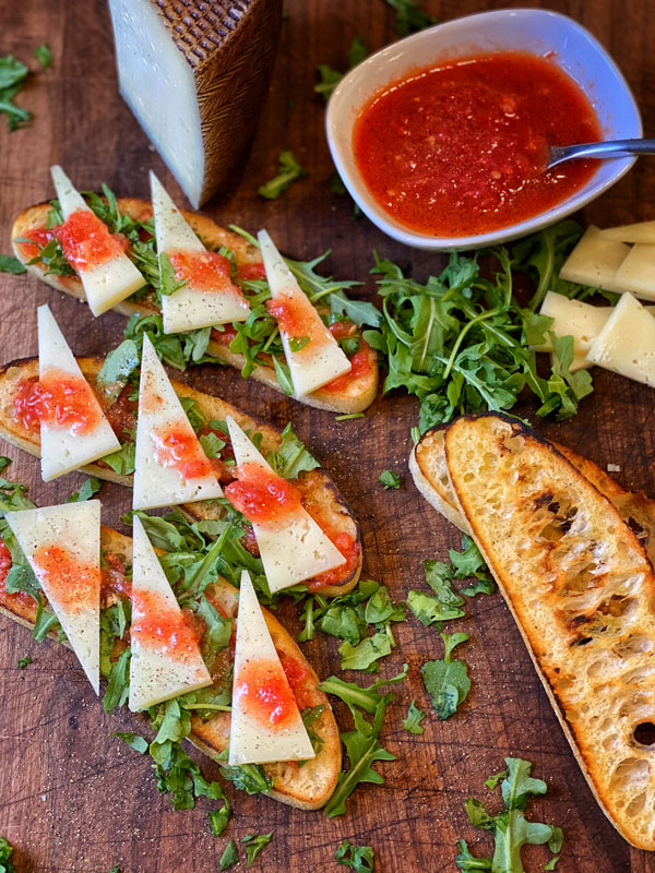 Grilled Ciabatta Bread with Tomato Dip and Manchego Cheese ready to serve