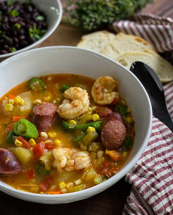 Spicy low country boil served with bread and greens