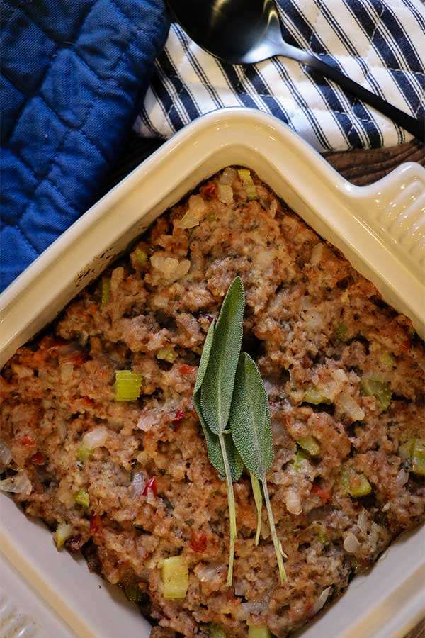 Cranberry and sausage stuffing with sage garnish