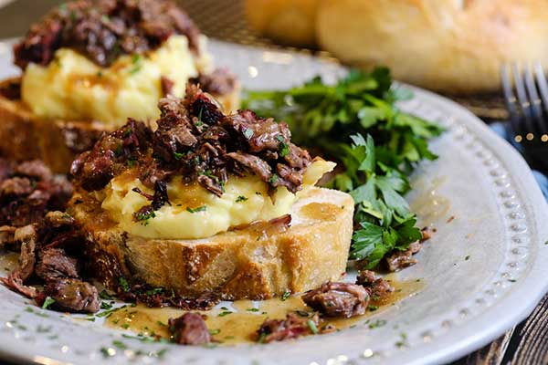 Open-faced hot beef sandwich ready to eat