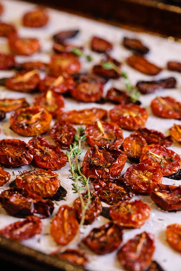 Freshly roasted tomatoes removed from the oven and cooling