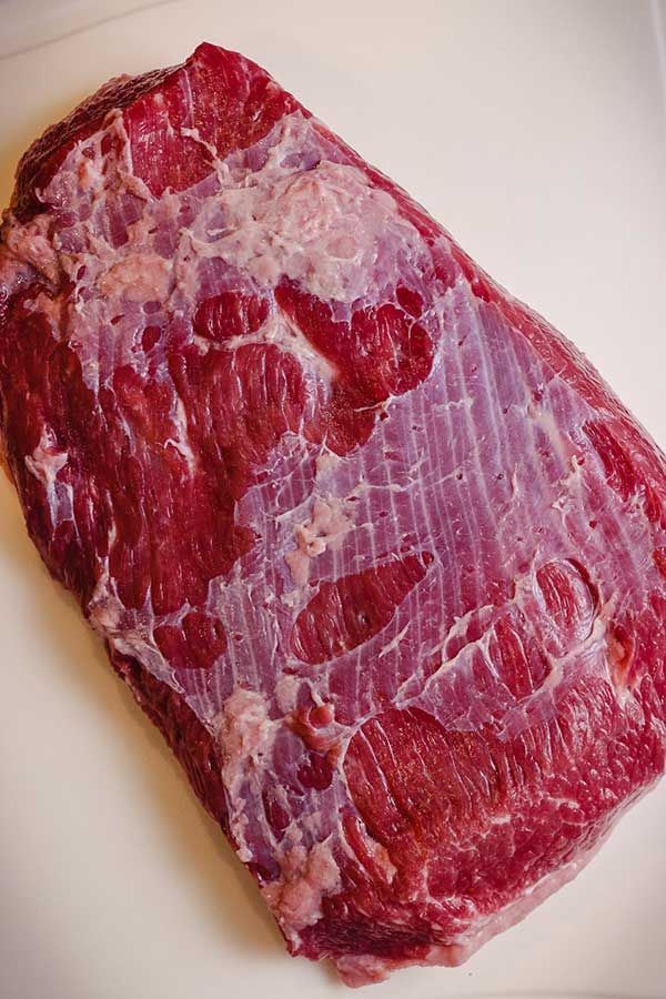 Sinew covers the top of a corned beef brisket.