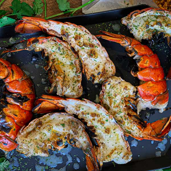 Grilled lobster tail halves ready to serve