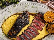Bourbon marinated strip steak, grilled and served on a bed of polenta with grilled oranges