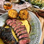 Bourbon marinated strip steak, grilled and served on a bed of polenta