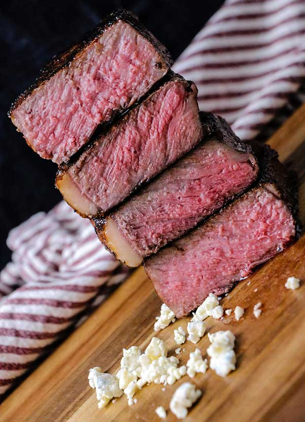 reverse sear results in uniformly cooked steak that is pink in the middle and seared on the outside