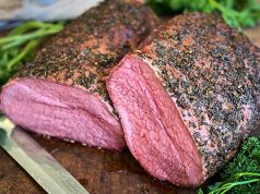 Smoked eye of round roast beef on a cutting board