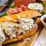 Fresh bread, homemade horseradish sauce and au jus sauce combined with smoked roast beef