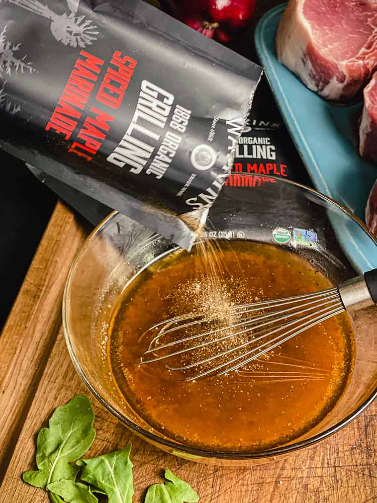 adding Watkins Organic Spiced Maple Marinade to oil, honey, water and vinegar
