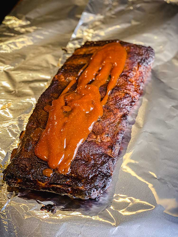 St. Louis Style ribs glazed with sauce