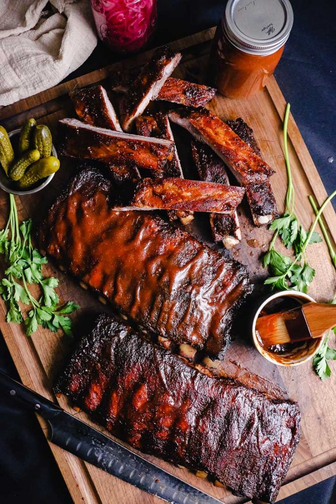Overhead shot of barbecue ribs sliced with sauces