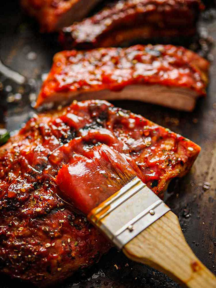 Homemade bbq sauce with freshly grilled ribs