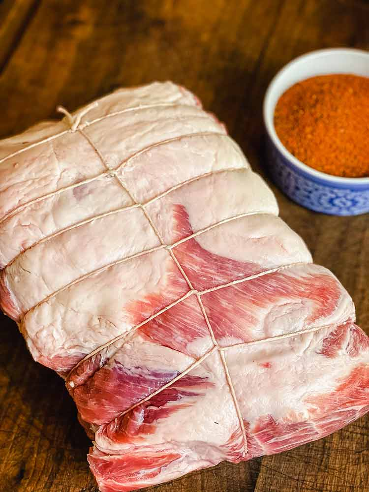 pork shoulder wrapped in twine from side to side and top to bottom