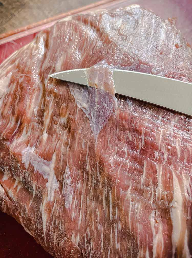 slicing off the silver skin of a tri-tip is easy with a sharp boning knife