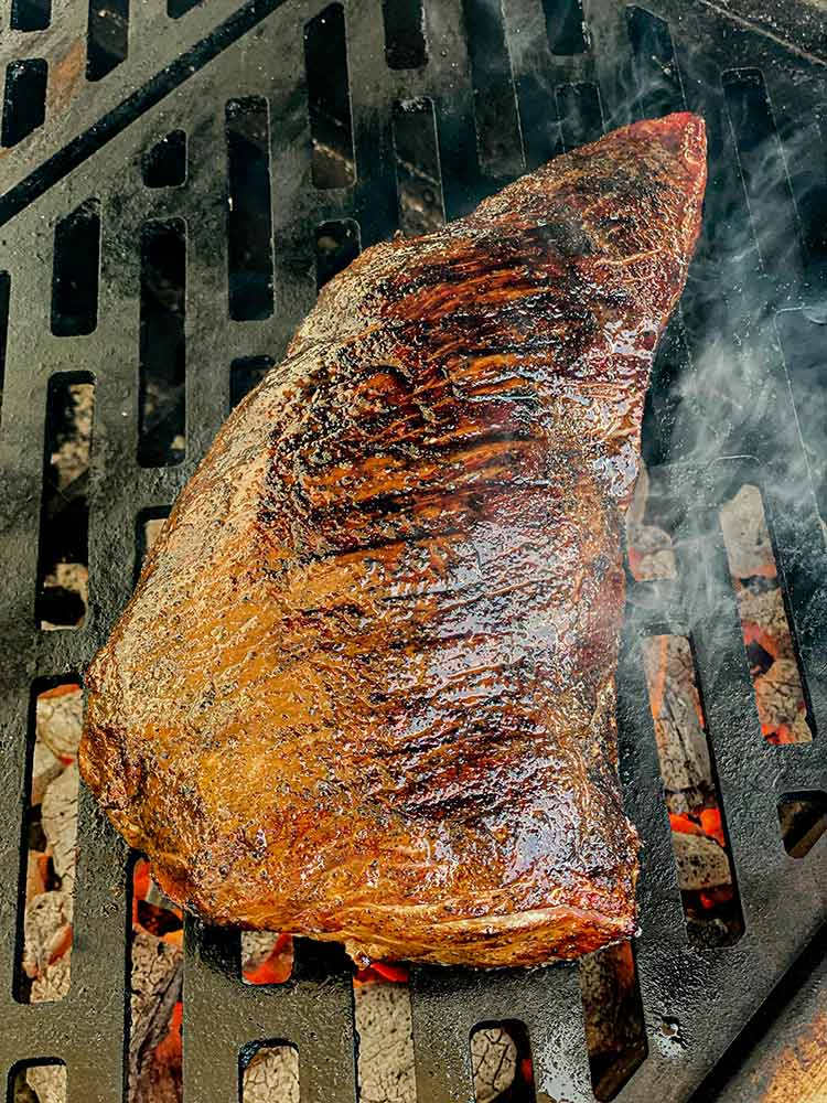 searing tri-tip on a grill