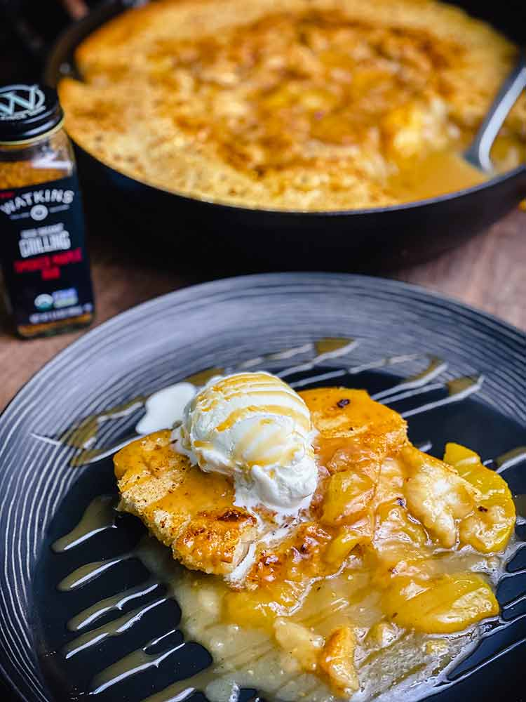 Peach cobbler topped with ice cream