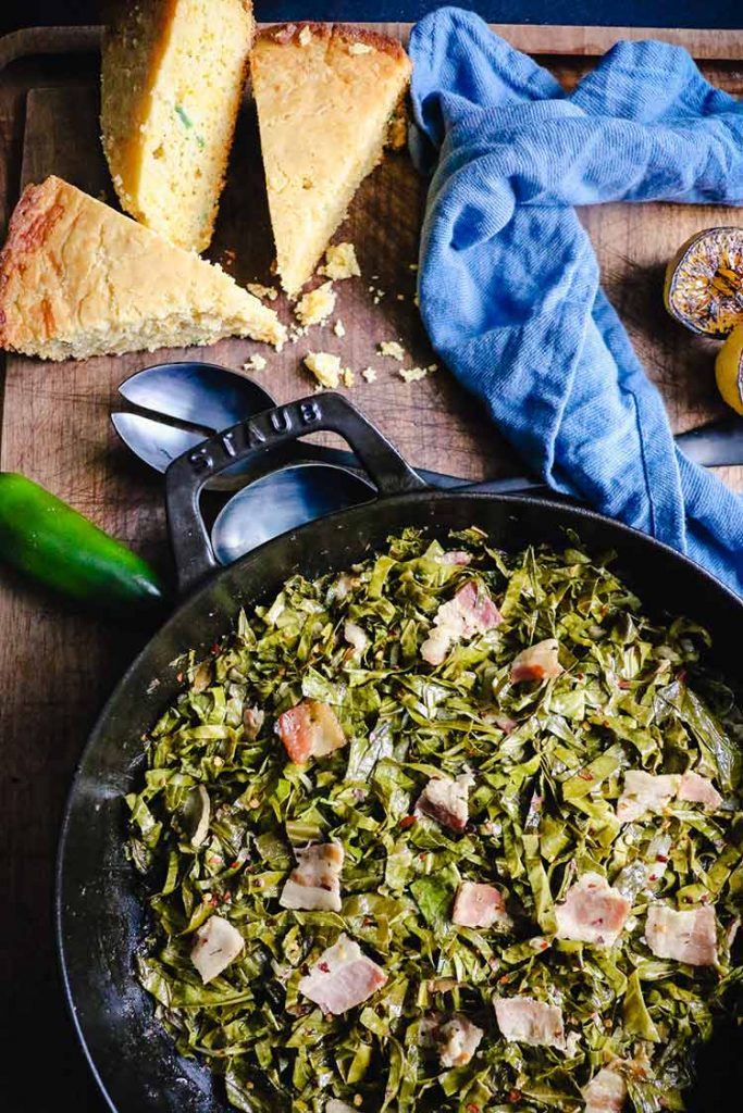 smoked collard greens with bacon tossed with red pepper flakes to serve