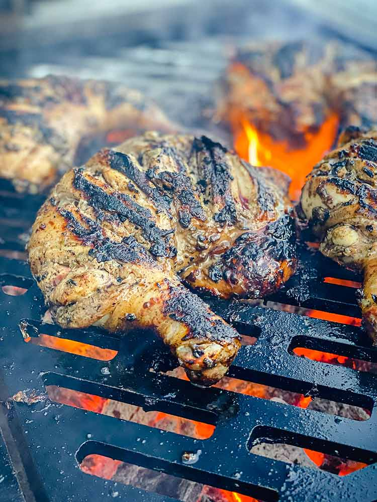 close up of charred chicken quarter